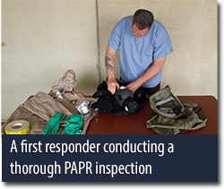 A first responder conducting a thorough PAPR inspection